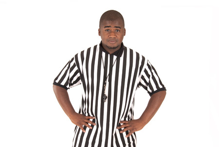 foul: Black referee calling offsides or blocking foul Stock Photo
