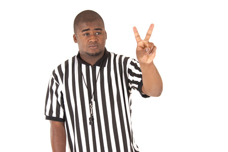 foul: Portrait black referee calling two shot foul Stock Photo