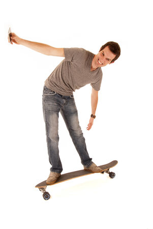 man on long board with cell phone photo