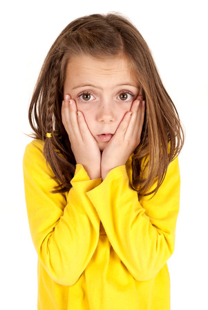 cute young girl with confused facial expression photo
