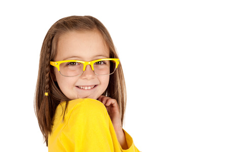 girl with glasses and huge expression smiling