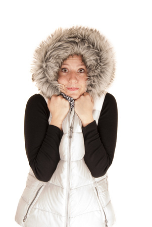 Woman in white winter fur hooded coat photo