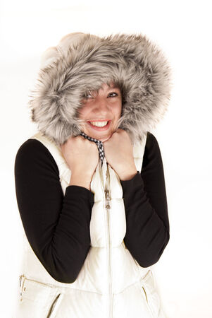 Pretty woman in winter coat fur hood photo