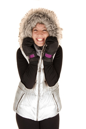 excited woman in winter coat with gloves photo