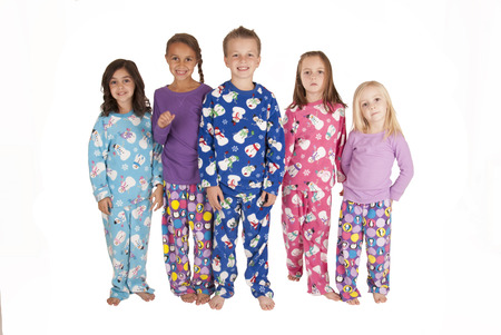 five young cousins wearing winter holiday pajamas   Stock Photo