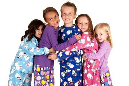 pajamas: Children hugging in christmas holiday fleece pajamas