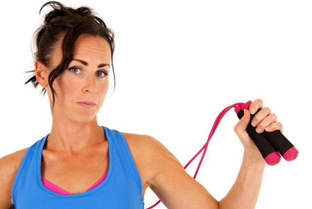 Woman with jump rope and workout clothes photo