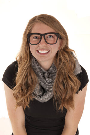 attractive young woman smiling wearing black glasses