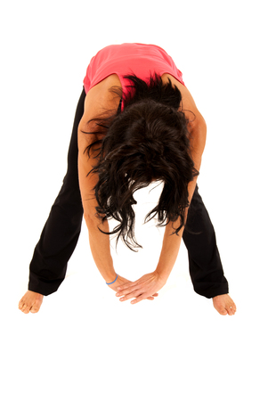 leaning forward: brunette fit woman stretching out leaning forward