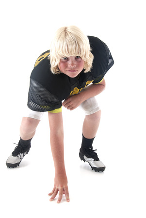 young American football player boy in stance  photo