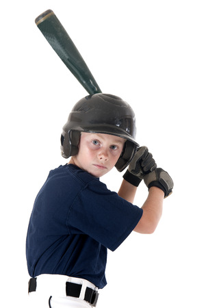 Young baseball player focused batting left handed Stock Photo