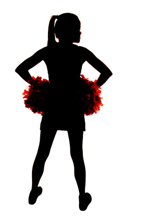 young cheerleader silhouette with hands on hips photo