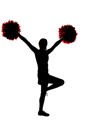Young cheerleader silhouette with hands in air Stock Photo