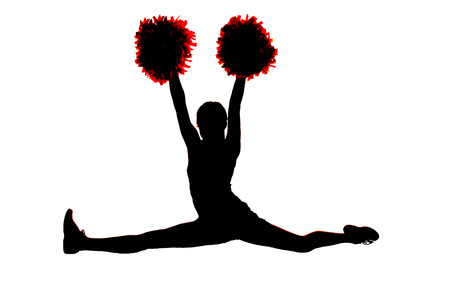 Young girl cheerleader silhouette doing the splits Stock Photo