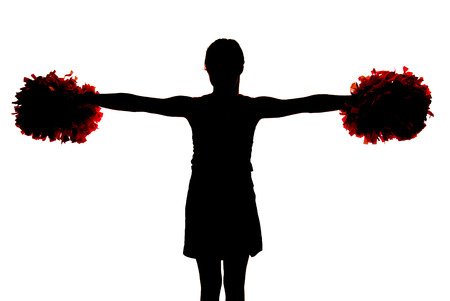 Silhouette of young cheerleader pompoms straight out photo