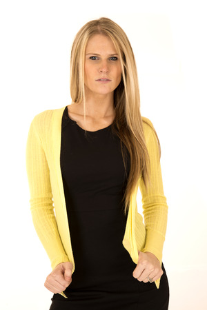cardigan: long blonde haired woman in yellow cardigan Stock Photo