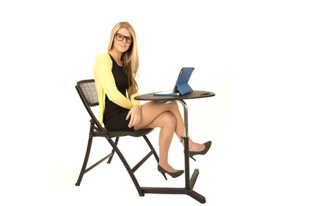 i pad: pretty blonde with glasses sitting at desk