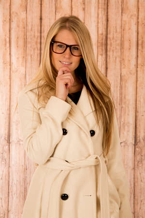 cute blonde woman in glasses holding chin  photo