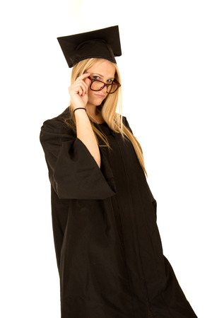 female college graduate Model peering over glasses  photo