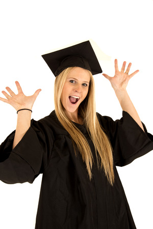 School graduate in cap and gown celebrating photo