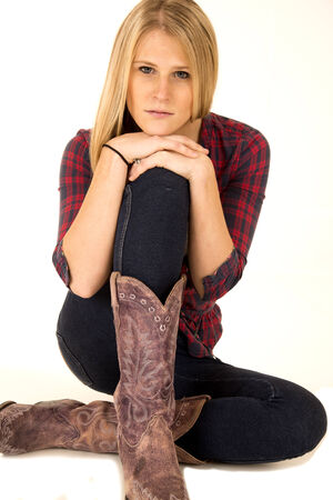 female model wearing cowboy boots sullen expression