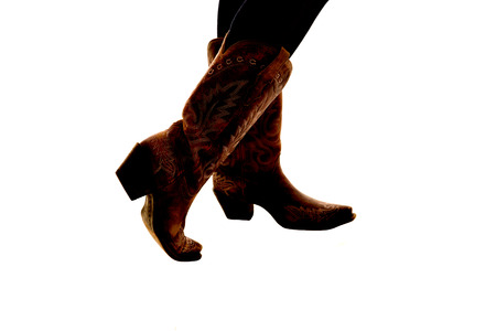 semi silhouette of cowboy boots white background