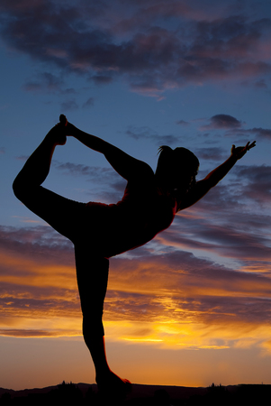 female model silhouette yoga pose sunset  photo