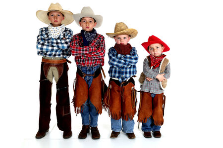young cowboy brothers standing arms folded serious photo