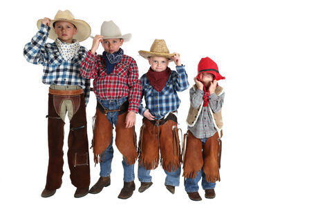 four young cowboys having fun posing silly