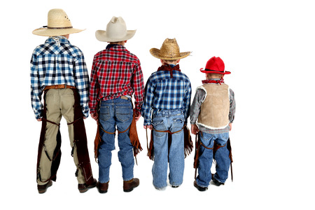 backside of four young cowboys white