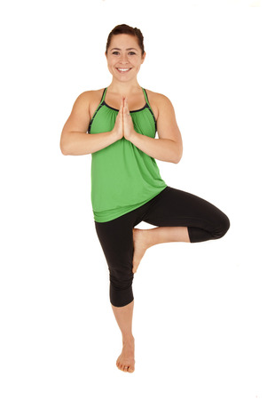 woman doing yoga pose tree leg up Stock Photo