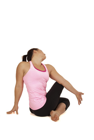twist: healthy woman doing yoga exercise seated twist