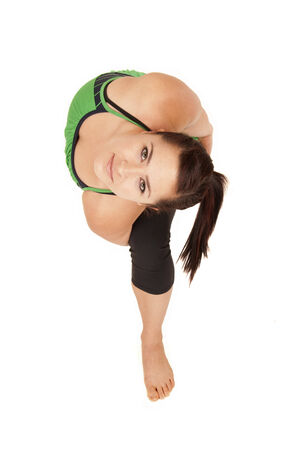 revolved: yoga instructor bound revolved side angle position Stock Photo