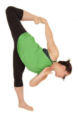 Yoga instructor in half moon bow pose photo