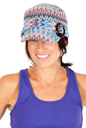 brunette wearing knit hat and tank top photo