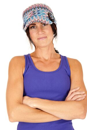 beautiful brunette wearing hat with arms folded photo
