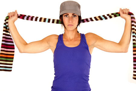 attractive brunette stretching striped scarf above shoulders photo