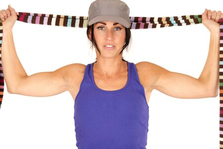 pretty brunette with serious expression stretching scarf  photo