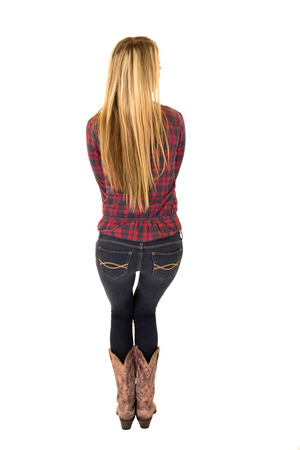 rearview of blond female model wearing cowboy clothing photo