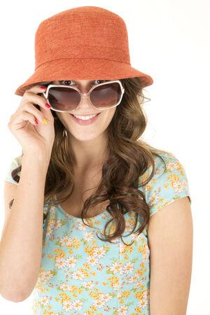 cute female model wearing orange hat sunglasses photo