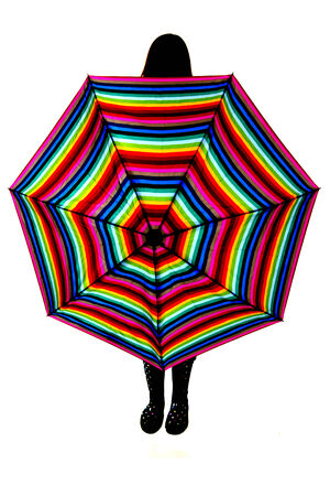 rainbow umbrella: Silhouetter of woman with a rainbow umbrella
