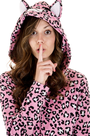 female model wearing pajamas finger to mouth photo