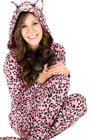 female model holding stuffed animal in pajamas Stock Photo