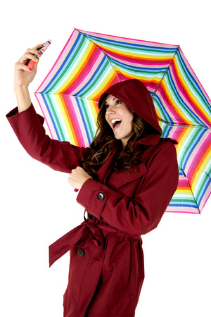 attractive model taking selfie holding rainbow umbrella photo