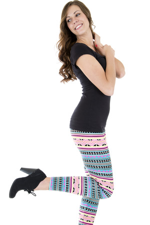 playful attractive female model wearing colorful leggings