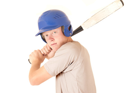 caucasian baseball batter focused expression wearing helmet photo