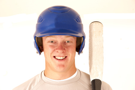 baseball player portrait smiling holding a bat photo