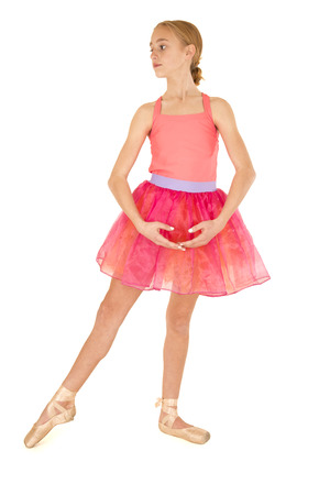 cute young girl ballerina posing in pink tutu photo