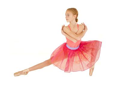 cute young redhead ballerina girl wearing pink photo