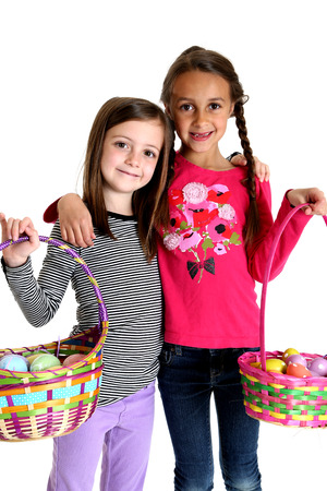 Two cute girls holding up Easter baskets photo
